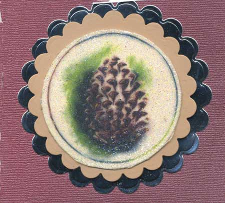 holiday card with glittered covered pine cone