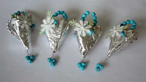 tussie mussies made with silver material and trimmed with turquoise beads