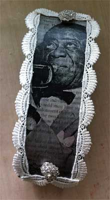 top of altered eyeglass case with image transfer of Satchmo