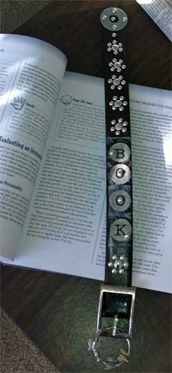 altered leather belt becomes a bookmark with silver beads