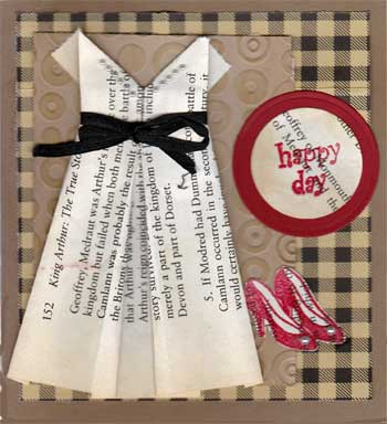 greeting card featuring an origami dress made with pages from a book