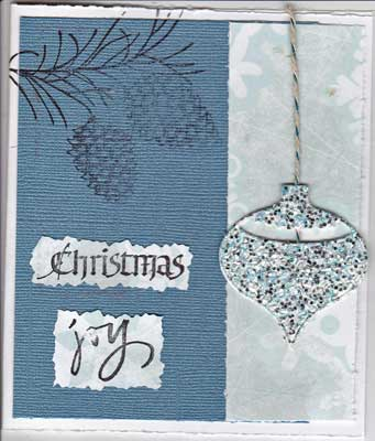 christmas card with stamped pine cone and die cut ornament