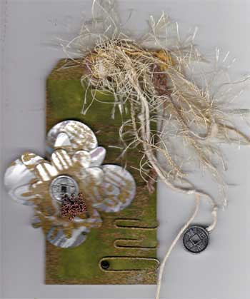 grunge tag with distressed metal flowers