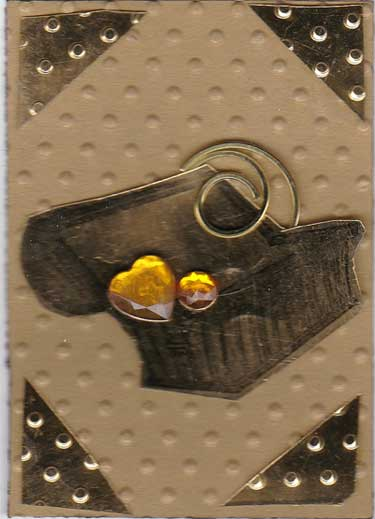 gold colored ATC with treasure chest and gems