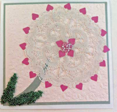 romantic card with a doily, hearts and flowers