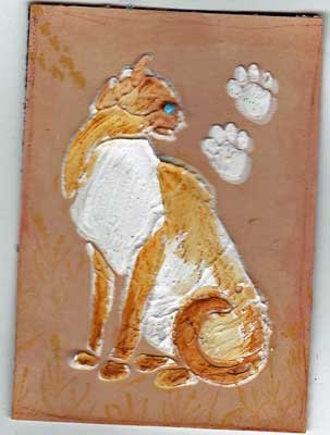 artist trading card in coral color showing cat made from a stencil