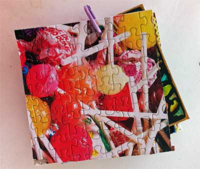 fat book cover made from jigsaw puzzle