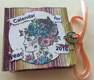 front of mini journal showing stamped head of vintage lady