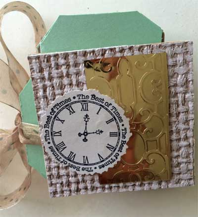 mini album back cover with stamped clock